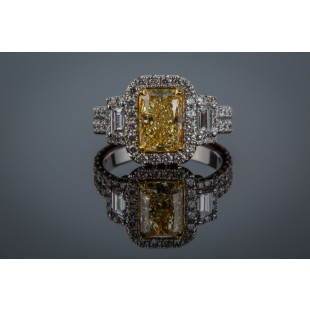 18K YELLOW AND WHITE GOLD FANCY YELLOW DIAMOND RING